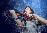 pictures-1920x1200-2010-Creative_Wallpaper_Girl_violin_water_022231_